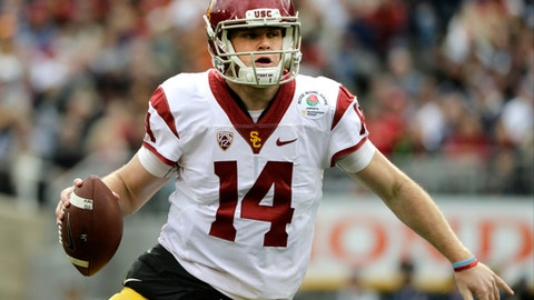 FILE - In this Jan. 2, 2017, file photo, Southern California quarterback Sam Darnold looks to pass against Penn State during the Rose Bowl NCAA college football game in Pasadena, Calif. Southern California and Washington are the strong favorites to win their respective Pac-12 divisions. (AP Photo/Jae C. Hong, File)