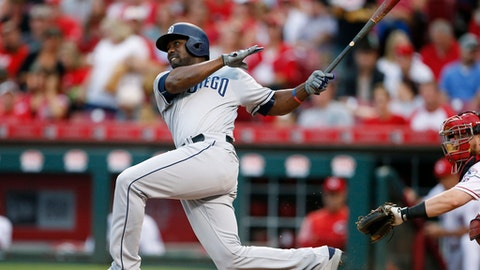 San Diego Padres' Jose Pirela (2) follows through on a two-run home run off Cincinnati Reds starting pitcher Tim Adleman during the fourth inning of a baseball game, Monday, Aug. 7, 2017, in Cincinnati. (AP Photo/Gary Landers)