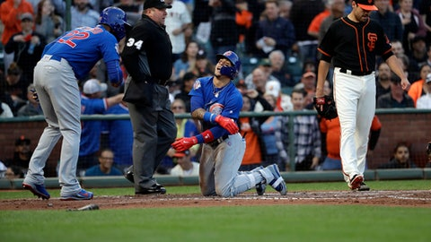 Chicago Cubs' Javier Baez, center, celebrates with teammate Jason Heyward, left, after Baez scored on an inside-the-park home run against the San Francisco Giants during the second inning of a baseball game Monday, Aug. 7, 2017, in San Francisco. (AP Photo/Marcio Jose Sanchez)