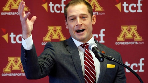 FILE - In this Jan. 6, 2017, file photo, new University of Minnesota head football coach addresses the media after he was introduced during a news conference in Minneapolis. The Gophers won nine games under Tracy Claeys in 2016, but things got ugly at the end with a threatened player bowl boycott and sexual assault investigation.(AP Photo/Jim Mone, File)