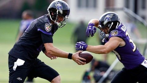 Baltimore Ravens quarterback Ryan Mallett, left, runs a drill with running back Danny Woodhead during an NFL football training camp practice in Owings Mills, Md., Tuesday, Aug. 8, 2017. (AP Photo/Patrick Semansky)