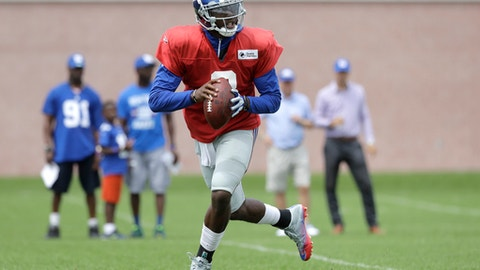 New York Giants quarterback Josh Johnson looks to pass during NFL football training camp, Tuesday, Aug. 8, 2017, in East Rutherford, N.J. (AP Photo/Julio Cortez)