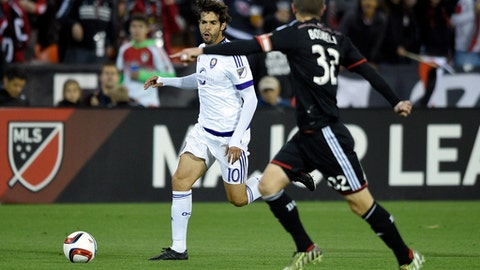 Orlando City midfielder Kaka (10) chases the ball against D.C. United defender Bobby Boswell (32) during the first half of an MLS soccer game, Wednesday, May 13, 2015, in Washington. (AP Photo/Nick Wass)