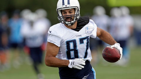 Tennessee Titans wide receiver Eric Decker runs a play during NFL football training camp Tuesday, Aug. 8, 2017, in Nashville, Tenn. (AP Photo/Mark Humphrey)