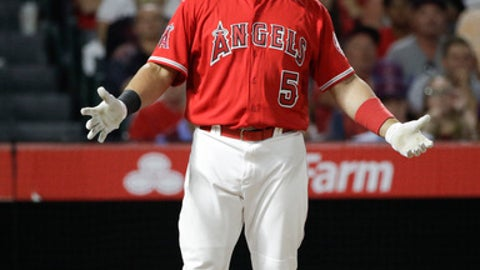 Los Angeles Angels' Albert Pujols gestures toward first base umpire Ramon De Jesus after striking out during the sixth inning of a baseball game against the Baltimore Orioles, Tuesday, Aug. 8, 2017, in Anaheim, Calif. (AP Photo/Jae C. Hong)