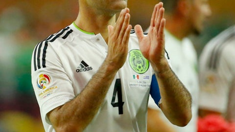 Mexico defender Rafael Marquez (4) leaves the pitch after a Copa America group C soccer match against Uruguay at University of Phoenix Stadium, Sunday, June 5, 2016, in Glendale, Ariz. Mexico won 3-1. (AP Photo/Matt York)