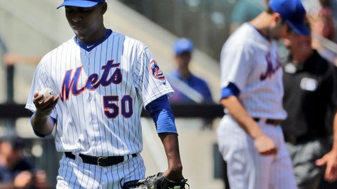 New York Mets pitcher Rafael Montero looks at the ball during the second inning of a baseball game against the Texas Rangers at Citi Field, Wednesday, Aug. 9, 2017, in New York. (AP Photo/Seth Wenig)