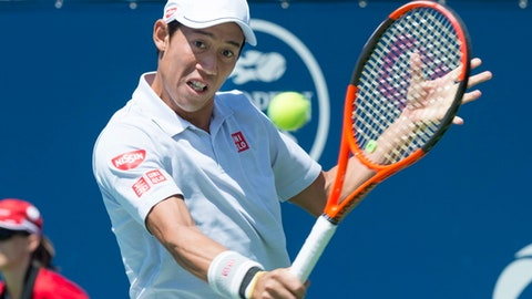 Kei Nishikori, of Japan, returns to Gael Monfils, of France, during second round of play at the Rogers Cup tennis tournament, Wednesday, Aug. 9, 2017 in Montreal. (Paul Chiasson/The Canadian Press via AP)