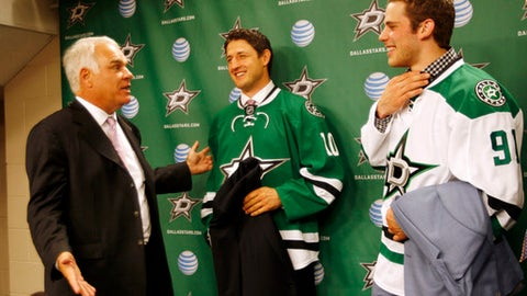 Dallas Stars President James Lites, left, talks with Shawn Horcoff, center, and Tyler Seguin after they are introduced as NHL hockey Dallas Stars players at a press conference in Dallas on Tuesday July 8, 2013. AP Photo/Mike Fuentes