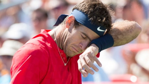 Juan Martin del Potro from Argentina wipes his face during his match against Denis Shapovalov of Canada during the Rogers Cup men's tennis tournament, Wednesday, Aug. 9, 2017 in Montreal. (Paul Chiasson/The Canadian Press via AP)