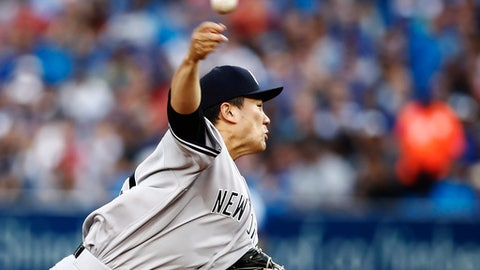 New York Yankees starting pitcher Masahiro Tanaka throws against the Toronto Blue Jays during the first inning of a baseball game in Toronto, Wednesday, Aug. 9, 2017. (Mark Blinch/The Canadian Press via AP)