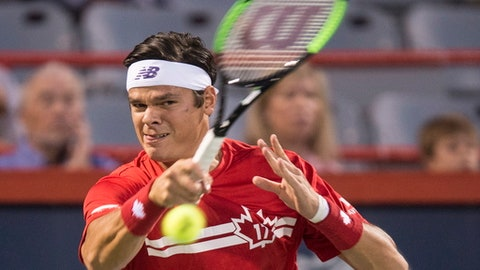 Milos Raonic of Canada returns to Adrian Mannarino of France during the Rogers Cup men's tennis tournament, Wednesday, Aug. 9, 2017 in Montreal. (Paul Chiasson/The Canadian Press via AP)