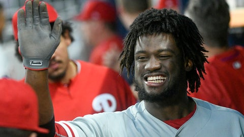Philadelphia Phillies' Odubel Herrera celebrates after scoring on a line drive triple to center field during the third inning of a baseball game against the Atlanta Braves, Wednesday, Aug. 9, 2017, in Atlanta. Herrera scored due to a throwing error by Atlanta Braves second baseman Ozzie Albies, and Freddy Galvis also scored on the play from first base. (AP Photo/John Amis)