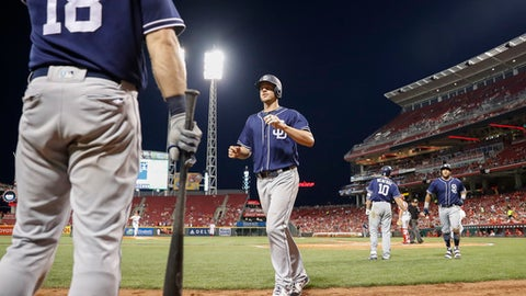 San Diego Padres' Wil Myers, center, celebrates after hitting a two-run home run off Cincinnati Reds starting pitcher Asher Wojciechowski during the sixth inning of a baseball game, Wednesday, Aug. 9, 2017, in Cincinnati. (AP Photo/John Minchillo)