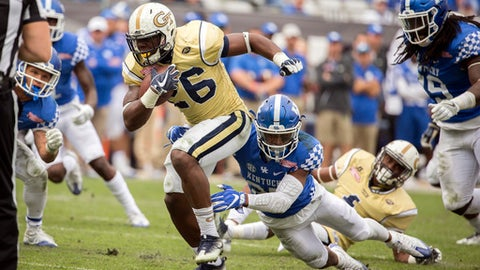 FILE - In this Saturday, Dec. 31, 2016 file photo, Georgia Tech running back Dedrick Mills (26) is tackled by Kentucky safety Mike Edwards (27) during the second half of the TaxSlayer Bowl NCAA college football game in Jacksonville, Fla. Georgia Tech is back on track. The Yellow Jackets rebounded emphatically from the worst season of coach Paul Johnson's tenure in Atlanta, winning nine games a year ago to re-establish a bit of swagger. (AP Photo/Stephen B. Morton, File)