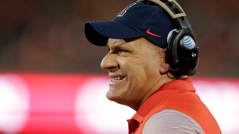 FILE - In this  Sept. 24, 2016, file photo, Arizona head coach Rich Rodriguez reacts during the first half of an NCAA college football game against Washington in Tucson, Ariz. (AP Photo/Rick Scuteri, File)