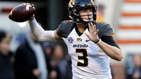 FILE - In this Nov. 19, 2016, file photo, Missouri quarterback Drew Lock (3) throws to a receiver during the first half of an NCAA college football game against Tennessee  in Knoxville, Tenn. (AP Photo/Wade Payne, File)