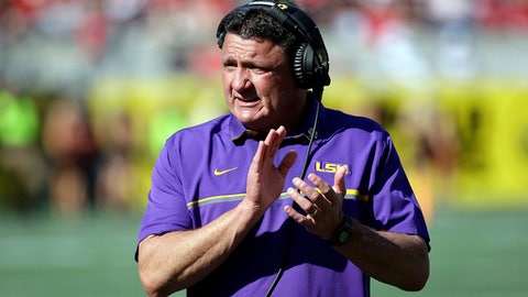 FILE - In this Dec. 31, 2016, file photo, LSU coach Ed Orgeron encourages players during the second half of the Citrus Bowl NCAA football game against Louisville in Orlando, Fla. Orgeron, a boisterous Cajun who is popular in his native Louisiana, is entering his first full season as LSU's head coach after taking over four games into last season, when former coach Les Miles was fired.  (AP Photo/John Raoux, File)