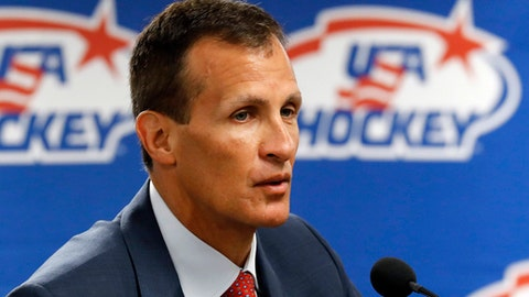 FILE - In this Aug. 4, 0217, file photo, Tony Granato, United States olympic men's hockey coach, speaks during a news conference in Plymouth, Mich., Friday, Aug. 4, 2017. Hockey Canada hired a full-time coach and has already begun playing exhibitions with five tournaments on the docket before February, while USA Hockey picked Granato, a college coach with an everyday job and figures less is more with pre-Olympic completion.  (AP Photo/Paul Sancya, File)