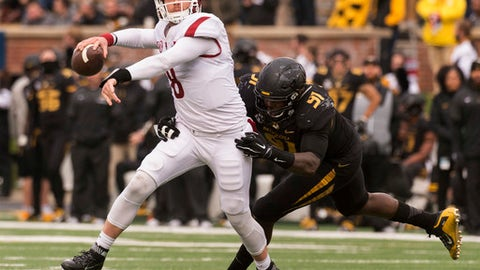 FILE - In this Nov. 25, 2016, file photo, Arkansas quarterback Austin Allen, left, is hit by Missouri's Charles Harris, right, as he throws the ball during the second quarter of an NCAA college football, in Columbia, Mo. Arkansas endured a frustrating offseason after its woeful defense blew large leads in back-to-back losses to end last season. The Razorbacks, with a new-look 3-4 defense and returning quarterback in Austin Allen, are hoping for a quick turnaround from last year's 7-6 record this season.  (AP Photo/L.G. Patterson, File)