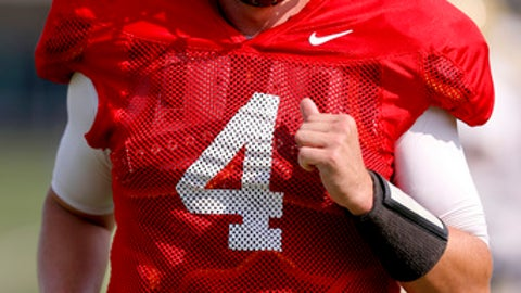 Pittsburgh quarterback Max Browne (4) runs in warmup during an NCAA college football practice, Thursday, Aug. 10, 2017, in Pittsburgh. (AP Photo/Keith Srakocic)