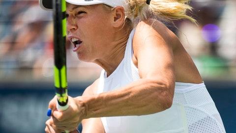 Caroline Wozniacki, of Denmark, returns the ball against Agnieszka Radwanska, of Poland, during a women's third round match at the Rogers Cup tennis tournament in Toronto, Thursday, Aug. 10, 2017. (Nathan Denette/The Canadian Press via AP)