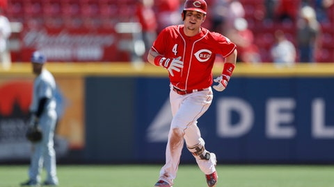 Cincinnati Reds' Scooter Gennett runs the bases after hitting a go-ahead grand slam off San Diego Padres relief pitcher Brad Hand in the seventh inning of a baseball game, Thursday, Aug. 10, 2017, in Cincinnati. (AP Photo/John Minchillo)