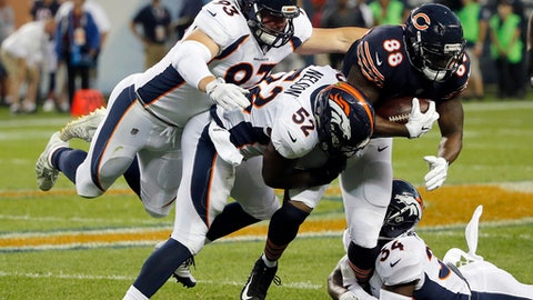 Chicago Bears tight end Dion Sims (88) is tackled by Denver Broncos defensive end Jared Crick (93), inside linebacker Corey Nelson (52) and defensive back Will Parks (34) during the first half of an NFL preseason football game, Thursday, Aug. 10, 2017, in Chicago. (AP Photo/Charles Rex Arbogast)