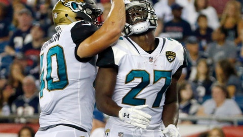 Jacksonville Jaguars running back Leonard Fournette (27) celebrates his touchdown against the New England Patriots with Tommy Bohanon, left, in the first half of an NFL preseason football game, Thursday, Aug. 10, 2017, in Foxborough, Mass. (AP Photo/Mary Schwalm)