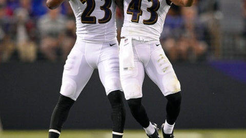 Baltimore Ravens strong safety Tony Jefferson, left, and defensive back Jaylen Hill celebrate after Hill intercepted a pass attempt in the first half of a preseason NFL football game against the Washington Redskins, Thursday, Aug. 10, 2017, in Baltimore. (AP Photo/Nick Wass)