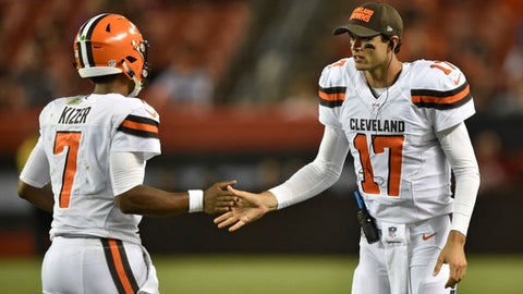 Cleveland Browns quarterback Brock Osweiler (17) congratulates quarterback DeShone Kizer after a Browns touchdown during the second half of an NFL preseason football game against the New Orleans Saints on Thursday, Aug. 10, 2017, in Cleveland. (AP Photo/David Richard)