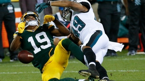 Green Bay Packers' Malachi Dupre loses the ball as he is hit by Philadelphia Eagles' Tre Sullivan during the second half of a preseason NFL football game Thursday, Aug. 10, 2017, in Green Bay, Wis. Dupre was taken off the field on a cart. (AP Photo/Mike Roemer)