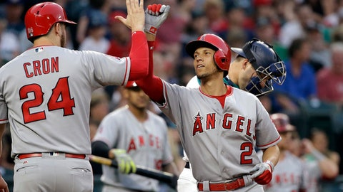 Los Angeles Angels' Andrelton Simmons (2) is congratulated by C.J. Cron on his two-run home run as Seattle Mariners catcher Mike Zunino waits for the next batter during the fourth inning of a baseball game Thursday, Aug. 10, 2017, in Seattle. (AP Photo/Elaine Thompson)