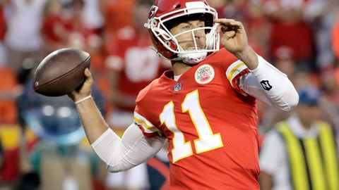 Kansas City Chiefs quarterback Alex Smith (11) throws during the first half of the team's NFL preseason football game against the San Francisco 49ers in Kansas City, Mo., Friday, Aug. 11, 2017. (AP Photo/Charlie Riedel)