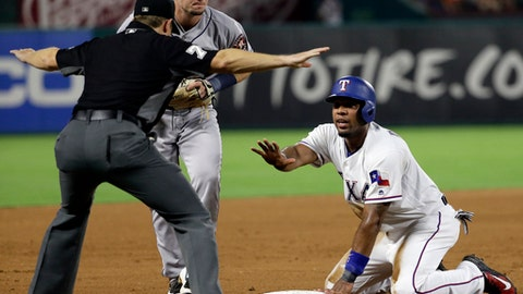 Third base umpire Tripp Gibson signals safe as as Houston Astros' Alex Bregman watches Texas Rangers' Elvis Andrus call for time after Andrus advanced on a fly out by Nomar Mazara during the fifth inning of a baseball game, Friday, Aug. 11, 2017, in Arlington, Texas. (AP Photo/Tony Gutierrez)
