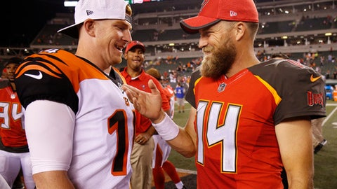 Cincinnati Bengals quarterback Andy Dalton, left, and quarterback Ryan Fitzpatrick, right, meet on the field after a preseason NFL football game, Friday, Aug. 11, 2017, in Cincinnati. (AP Photo/Gary Landers)
