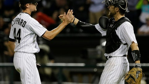 Chicago White Sox closer Tyler Clippard, left, celebrates with catcher Kevan Smith after they defeated the Kansas City Royals in a baseball game Friday, Aug. 11, 2017, in Chicago. (AP Photo/Nam Y. Huh)