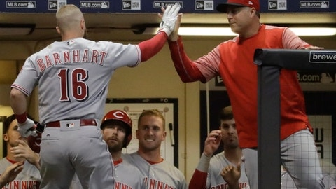 Cincinnati Reds' Tucker Barnhart is congratulated by manager Bryan Price after hitting a home run during the seventh inning of a baseball game against the Milwaukee Brewers Friday, Aug. 11, 2017, in Milwaukee. (AP Photo/Morry Gash)