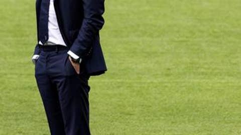 Juventus coach Massimiliano Allegri stands on the pitch during a training session the day before the Italy Supercup soccer match, at Rome's Olympic stadium, Saturday, Aug. 12, 2017. Lazio will play Juventus in a Supercup match Sunday, Aug. 13. (Angelo Carconi/ANSA via AP)
