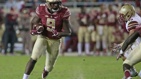 FILE - This Nov. 11, 2016 photo shows Florida State's Jacques Patrick looking for running room against Boston College's defense in an NCAA college football game in Tallahassee, Fla.  After two years of being behind Dalvin Cook on the depth chart, Jacques Patrick is ready to take the lessons he learned from watching Cook and become Florida State's lead running back this season. (AP Photo/Steve Cannon)