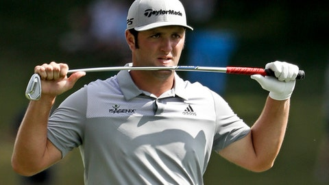 Jon Rahm, of Spain, reacts to his second shot on the 18th hole during the third round of the PGA Championship golf tournament at the Quail Hollow Club Saturday, Aug. 12, 2017, in Charlotte, N.C. (AP Photo/John Bazemore)
