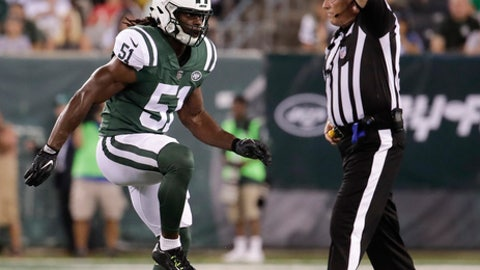 New York Jets inside linebacker Julian Stanford (51) celebrates after sacking Tennessee Titans quarterback Alex Tanney (11) during the second quarter of an NFL football game, Saturday, Aug. 12, 2017, in East Rutherford, N.J. (AP Photo/Julio Cortez)