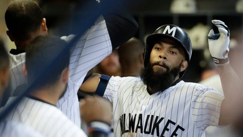 Milwaukee Brewers' Eric Thames celebrates a home run during the sixth inning of a baseball game against the Cincinnati Reds Saturday, Aug. 12, 2017, in Milwaukee. (AP Photo/Morry Gash)