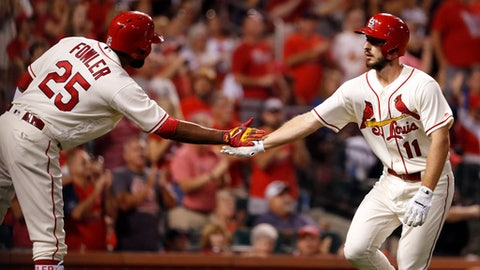 St. Louis Cardinals' Paul DeJong (11) is congratulated by teammate Dexter Fowler after hitting a solo home run during the seventh inning of a baseball game against the Atlanta Braves on Saturday, Aug. 12, 2017, in St. Louis. (AP Photo/Jeff Roberson)