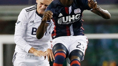New England Revolution's Kei Kamara (23) heads the ball in front of Vancouver Whitecaps' Jake Nerwinski (28) during the first half of an MLS soccer game, Saturday, Aug. 12, 2017, in Foxborough, Mass. (AP Photo/Michael Dwyer)
