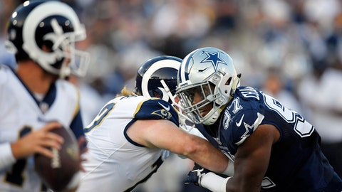 Dallas Cowboys defensive end Taco Charlton, right, gets past Los Angeles Rams offensive tackle Pace Murphy, center, during the first half of a preseason NFL football game Saturday, Aug. 12, 2017, in Los Angeles. (AP Photo/Mark J. Terrill)