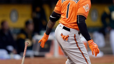 Baltimore Orioles' Tim Beckham drops his bat after hitting a double off Oakland Athletics' Michael Brady during the fourth inning of a baseball game Saturday, Aug. 12, 2017, in Oakland, Calif. (AP Photo/Ben Margot)