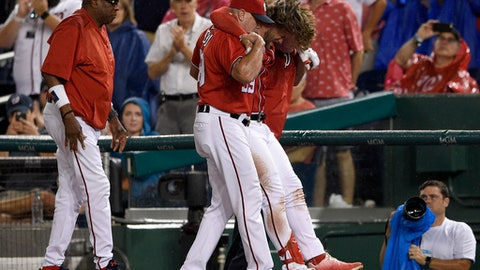 Washington Nationals' Bryce Harper, second from right, is helped off the field after he was injured during the first inning of a baseball game against the San Francisco Giants, Saturday, Aug. 12, 2017, in Washington. (AP Photo/Nick Wass)