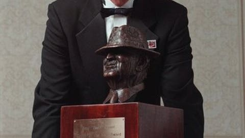 """FILE - In this Dec. 10, 1998, file photo, Kansas State University NCAA college head football coach Bill Snyder poses with the 1998 Paul """"Bear"""" Bryant Coach of the Year Award, in Houston. Snyder was hired at Kansas State in 1988, when new Oklahoma coach Lincoln Riley was 5 years old, and will begin his 26th season on Sept. 2 with a team expected to once again contend for a title. (AP Photo/Michael Stravato, File)"""
