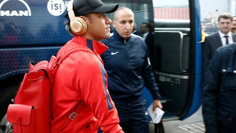 Paris Saint-Germain's Neymar gets off the team bus ahead of his French League One soccer match against Guingamp at the Roudourou stadium in Guingamp, western France, Sunday, Aug. 13, 2017. Neymar is expected to make his long-awaited debut with Paris Saint-Germain on Sunday in the small Brittany town of Guingamp. French soccer authorities finally receive the Brazil star's international transfer certificate. (AP Photo/Kamil Zihnioglu)